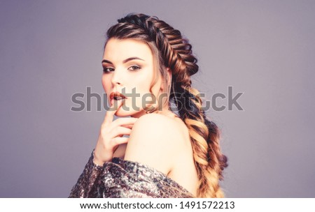 French braid. Professional hair care and creating hairstyle. Braided hairstyle. Beautiful young woman with modern hairstyle. Beauty salon hairdresser art. Girl makeup face braided long hair. #1491572213
