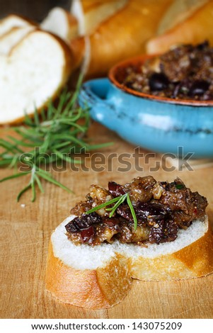 French bread with Fig Tapenade prepared with figs, kalamata olives and ...