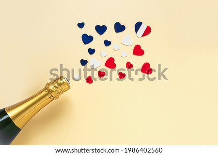 French champagne bottle and hearts in the colors of the French flag, top view, Bastille Day and French National Day concept Сток-фото ©
