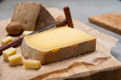 French cheese Comte, three varieties 1 year matured Prestige, fruity flavoured Fruite and Vieille Reserve close up