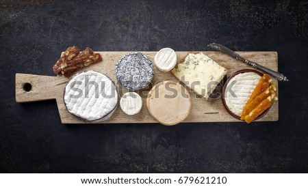 Shutterstock French Cheese Platter with Spanish Dulce de Membrillo as top view on a wooden board