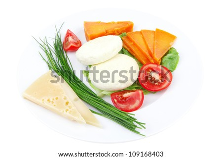 french cheeses : delicatessen aged cheeses with soft feta chops served on white plate with slices isolated on white background