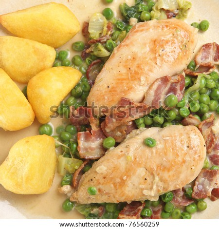 French chicken with bacon and peas served with roast potatoes.