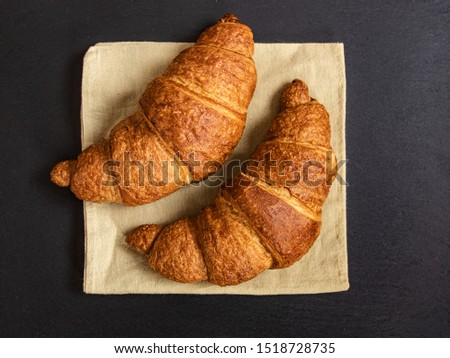 French croissant background. Two croissants top view.
