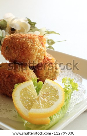 French cuisine, croquette with lemon and lettuce