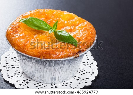 French  cuisine- julienne. Mushroom, chicken and cheese gratin in Aluminum Foil Mini Baking cup decorated with basil leaves, on black background,  authentic recipe,close-up #465924779