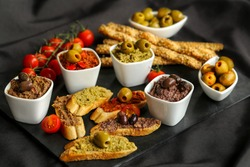 french cuisine, tapenade made with olives capers and provence herbs on a slate