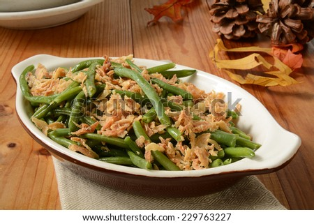 French cut green beans with crispy fried onions in a small casserole dish, a traditional holiday food