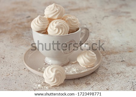 French dessert Meringue prepared from whipped with sugar and baked eggs.A cup of home-made meringues  ストックフォト ©