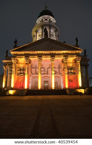 French Dome (Franzosischer Dom) lit by colorful lights, Berlin, Germany