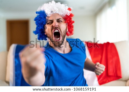 french fan celebrating at home. ...