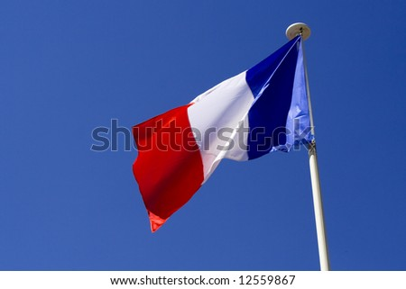 French flag against the clear blue sky