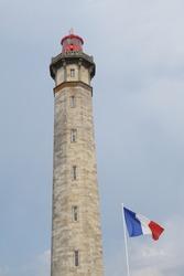 French flag at lighthouse phare des baleines, ile de ré, France