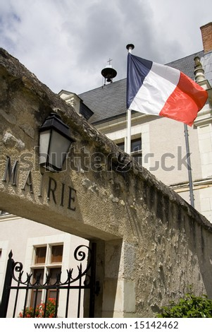 French flag flying outside a local town hall