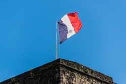 French flag on a top of Fort Saint Louis in Fort-de-France, France's Caribbean overseas department of Martinique, Lesser Antilles, French West Indies