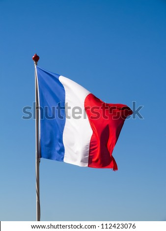 French flag pole against clear blue sky