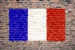French flag sprayed on brick wall