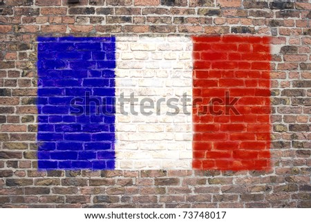 French flag sprayed on brick wall
