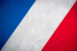 French flag tricolour street art background on textured grunge concrete wall