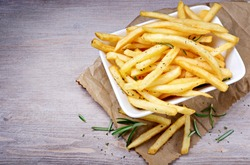 French fries, Chips on wood background. Top view, space for text.