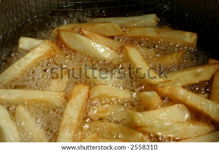 french fries cooking in hot oil