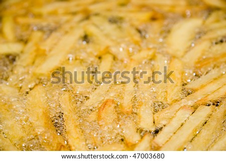 French fries frying in hot oil