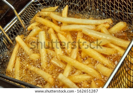 French fries in a deep fryer closeup Stockfoto ©