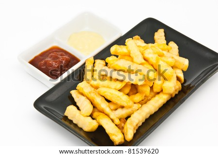 French fries in black plate on white background