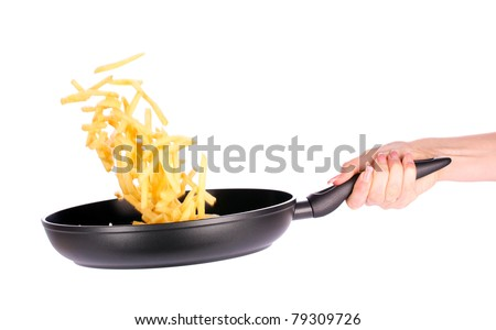 French fries in the pan isolated on white