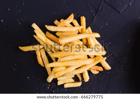 French fries on a dark background (top view) #666279775