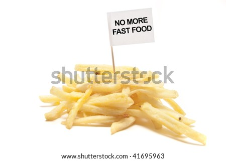 """french fries with flag """"no more fast food"""" separated - stock photo"""