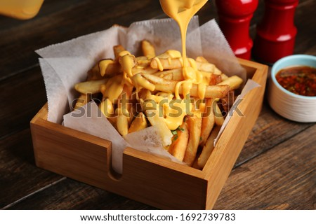 french fries with melted cheddar cheese on top