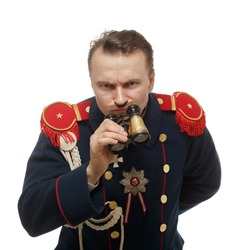 French general with beautiful mustache holding binoculars. Isolated on white.