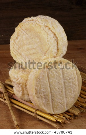 french goats cheese on a straw mat