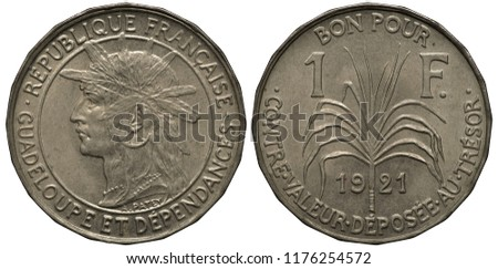 French Guadeloupe coin 1 one franc 1921, Indian head left within central circle, sugar cane stem divides denomination and date,