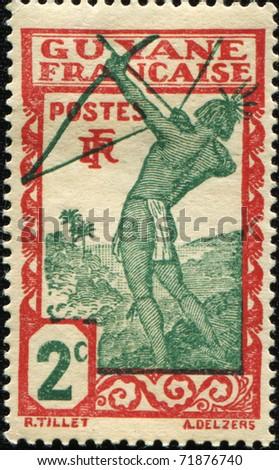 FRENCH GUIANA - CIRCA 1929: A stamp printed in French Guiana show Caribean archer, circa 1929