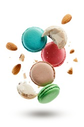 French macarons with almonds crushed into pieces. Colorful macaroons on white background.