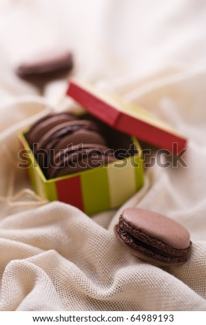 French macarons with dark chocolate - stock photo