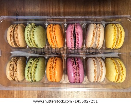 French macaroon is a sweet meringue-based confection made with egg white, icing sugar, granulated sugar, almond powder or ground almond, and food coloring.