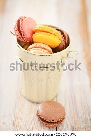 French macaroons in the cup. Close up. DOF