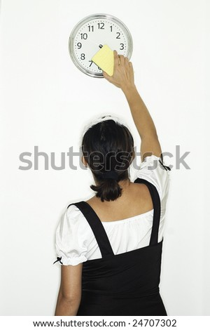 French Maid cleaning wall clock