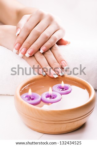 french manicure  with aromatic candles and towel