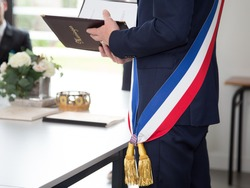 French mayor with a scarf flag during weeding day