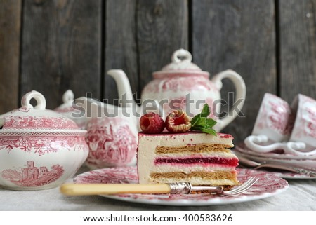 French modern velour honey chocolate cake with fresh raspberries, mint,vintage pink english porcelain
