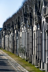 French monuments, tombs in the cemetery. French cemetery architecture.