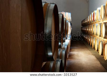 French Oak barrels with wine being stored in Pleisir de Merle wine cellar in Franschhoek, Western Cape, South Africa