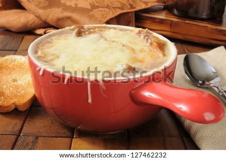 French onion soup topped with Gruyere cheese and toast