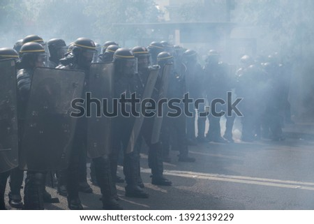 French police officers stand guard during the May Day protest in Paris, France. 01/05/19 #1392139229