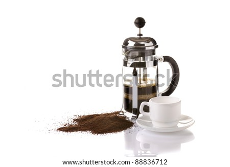 French press coffee maker on white background with reflection