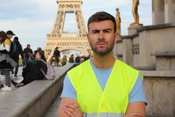French protester in front of the Eiffel Tower